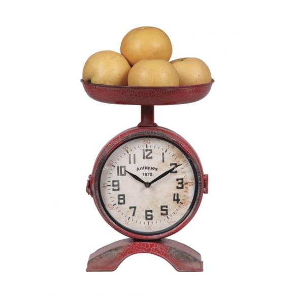 Punainen metallinen kaksipuolinen vaa'an muotoinen kello
